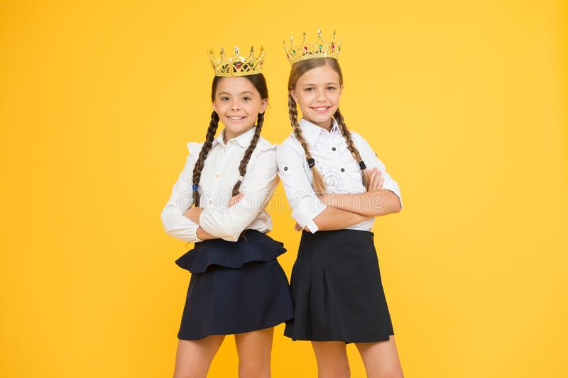 Dreaming about fame and richness. Award coronation. Brilliant pupils. Schoolgirls wear golden crowns symbol of respect. Award and respect. Cute princess stock photos