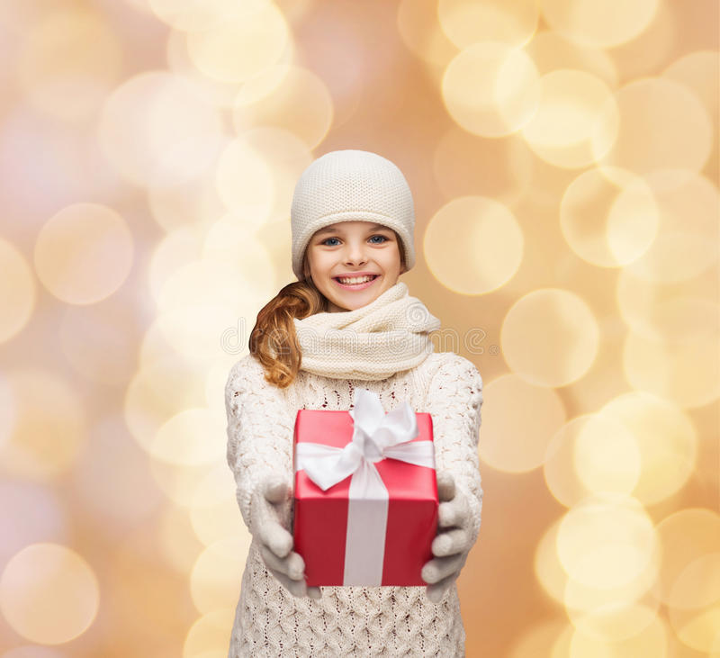 Free Dreaming Girl In Winter Clothes With Gift Box Stock Photos - 44710613