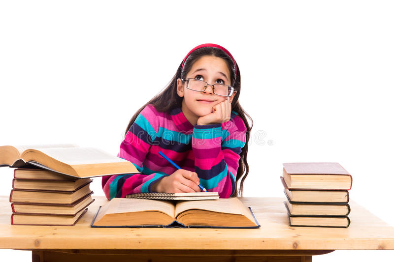Dreaming girl with pile of books royalty free stock image