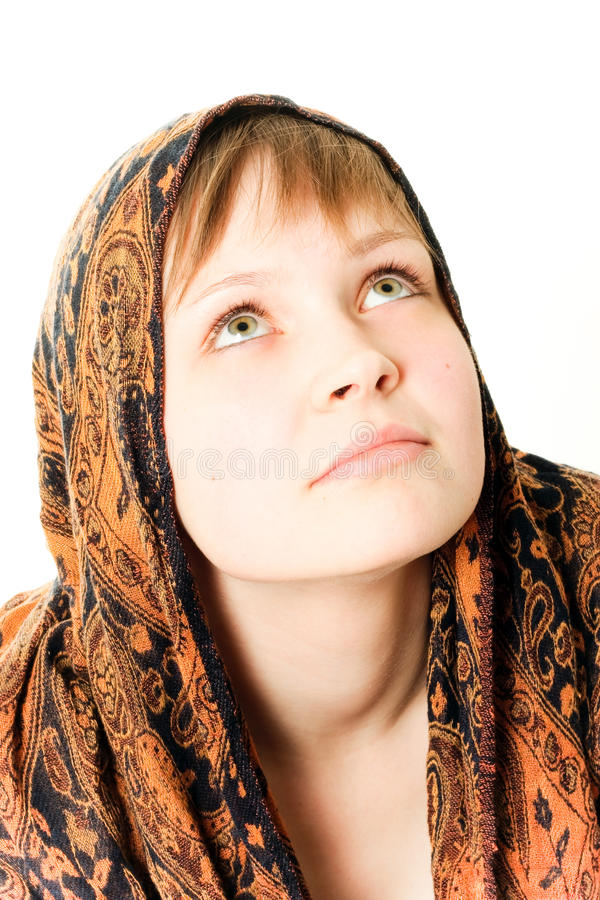 Dreaming girl with tied kerchief around her head royalty free stock photos