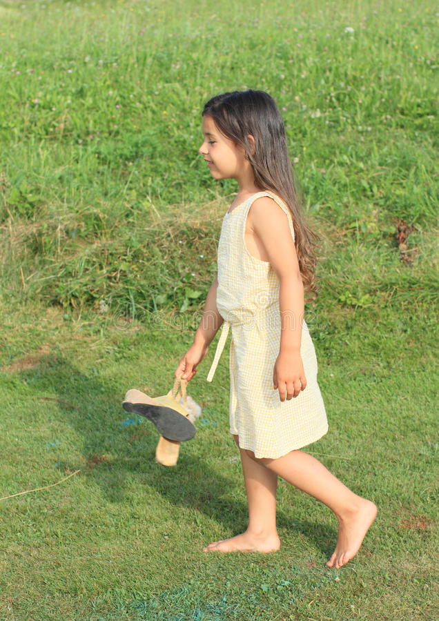 Download Dreaming Girl Walking Barefoot Royalty Free Stock Photo - Image: 32827155