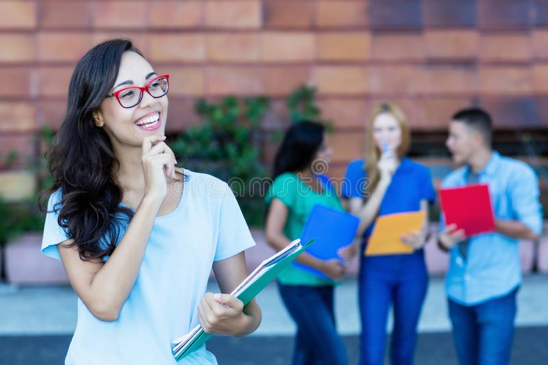 Dreaming nerdy french female student with group of students stock photos