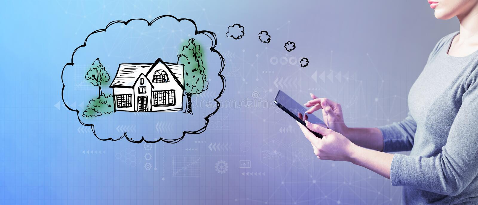 Dreaming of new home with woman using a tablet royalty free stock photography