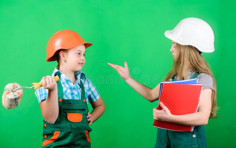 Dreaming about new playroom. Home improvement activities. Future profession. Kids girls planning renovation. Children. Sisters run renovation their room royalty free stock image