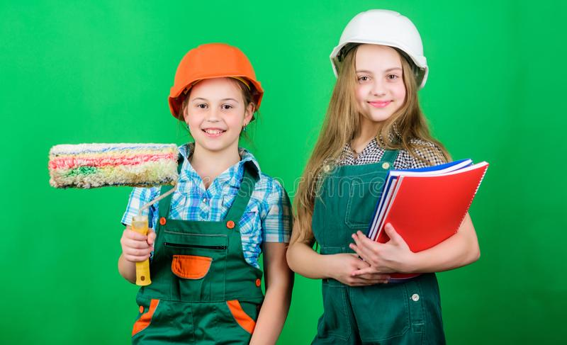 Dreaming about new playroom. Home improvement activities. Future profession. Kids girls planning renovation. Initiative. Children provide renovation their room stock photos