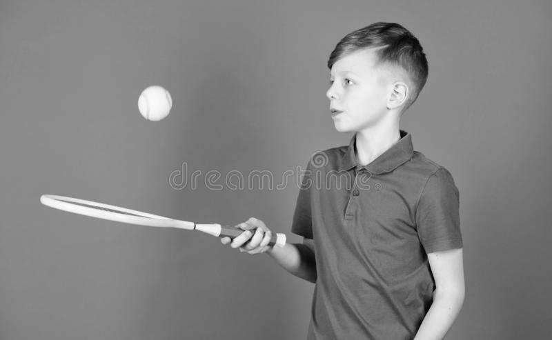 Dreaming about sport career. Athlete kid tennis racket on blue background. Tennis sport and entertainment. Boy child. Play tennis. Practicing tennis skills. Guy stock photo