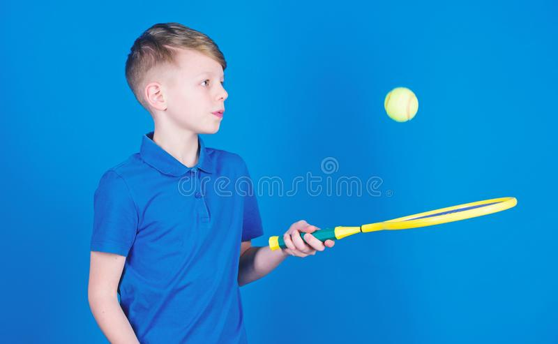 Dreaming about sport career. Athlete kid tennis racket on blue background. Tennis sport and entertainment. Boy child. Play tennis. Practicing tennis skills. Guy royalty free stock photography