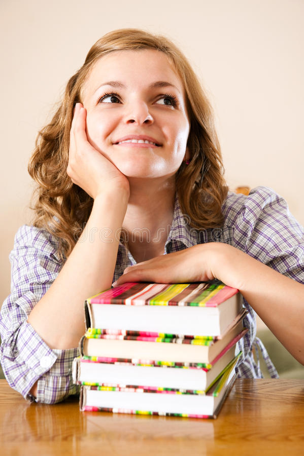 Download Dreaming Student With Books Stock Photo - Image: 27238066