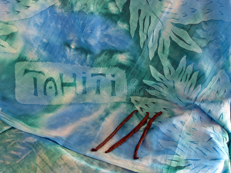 Dreaming of Tahiti. A Tahitian Pare-us with vanilla beans. Both purchased in Tahiti. This depicts my desire to return royalty free stock photos