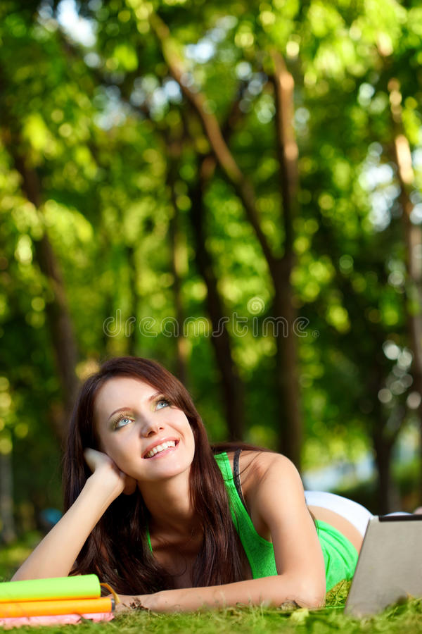 Dreaming woman laying on grass royalty free stock photo