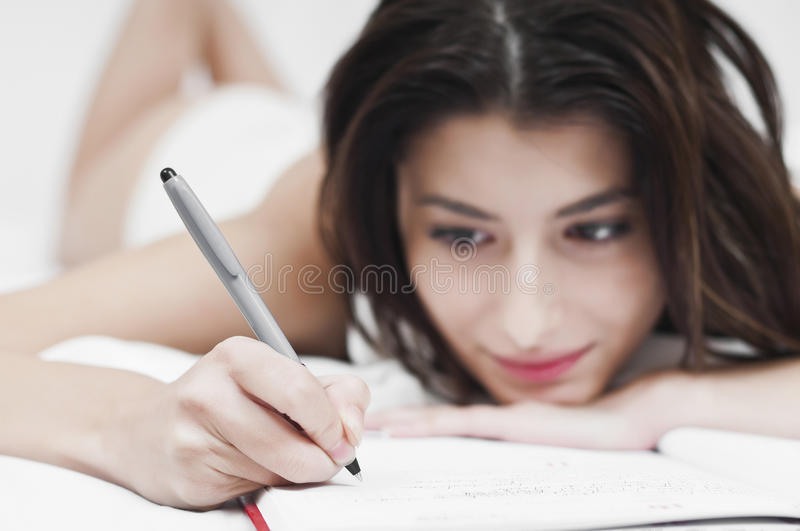 Download Dreaming Woman Writing On A Notebook Stock Photo - Image of dream, people: 22091886