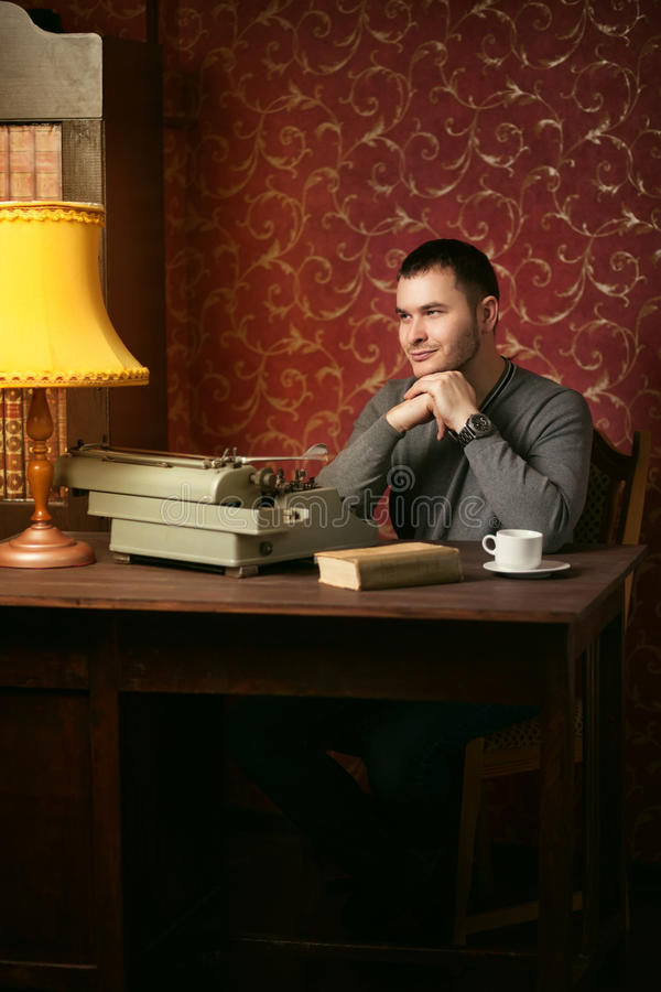 Dreaming writer with typewriter royalty free stock photography