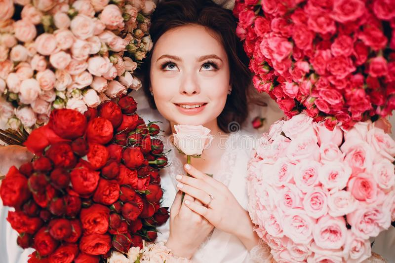 Dreaming young female and flowers royalty free stock images