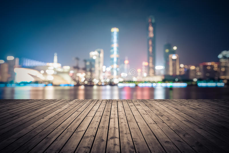 Dreamlike city background of guangzhou skyline cityscape. Dreamlike city background of the pearl river in guangzhou at night with wooden floor as a prospect stock photography