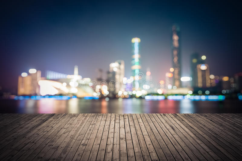 Dreamlike city background of the pearl river in guangzhou. Dreamlike city background of guangzhou skyline at night with wooden floor as a prospect stock photos
