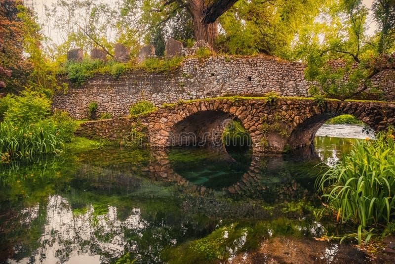 Dreamlike medieval fantasy forest fairy landscape river bridge stock photos