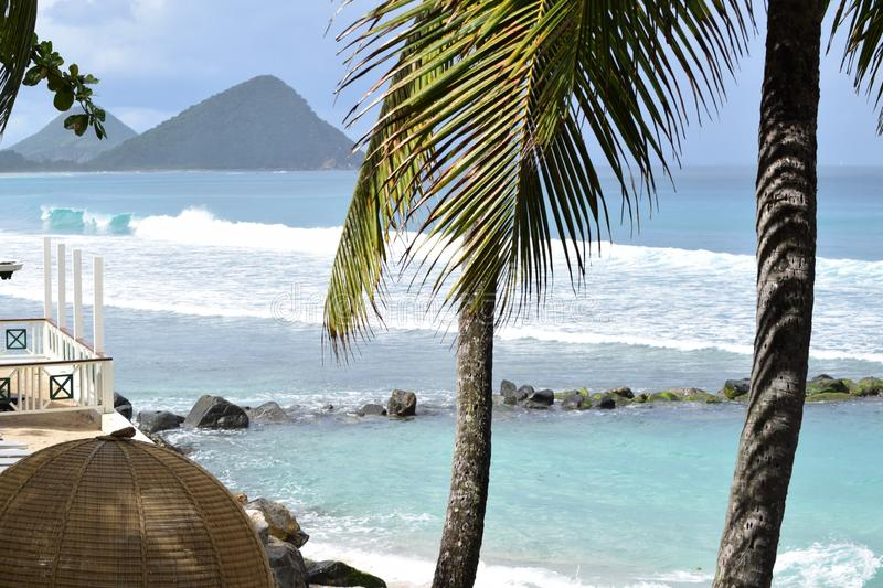 Dreamlike view on smooth waves and hills on Tortola, British virgin islands, Caribbean. Seen from the beach stock images