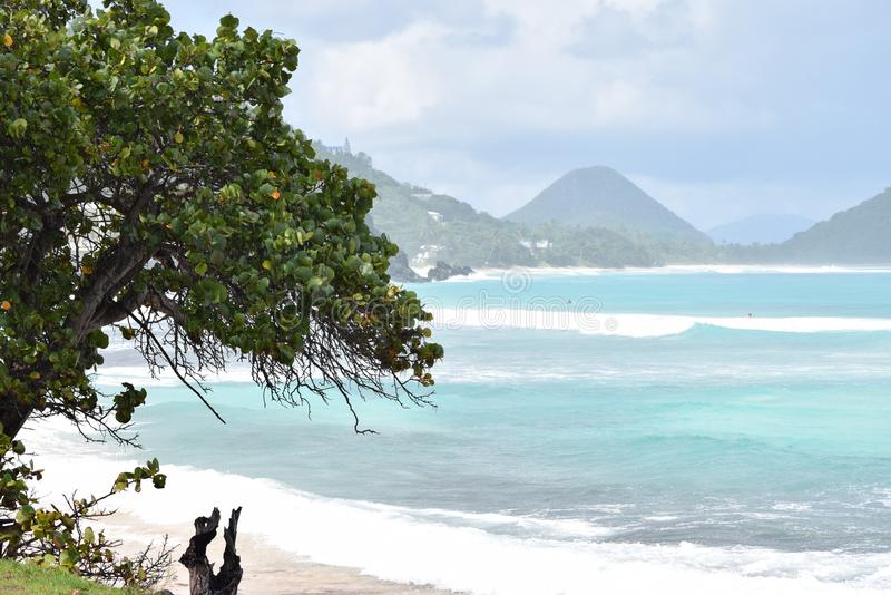 Dreamlike view on smooth waves and hills on Tortola, British virgin islands, Caribbean. Seen from the beach royalty free stock photos