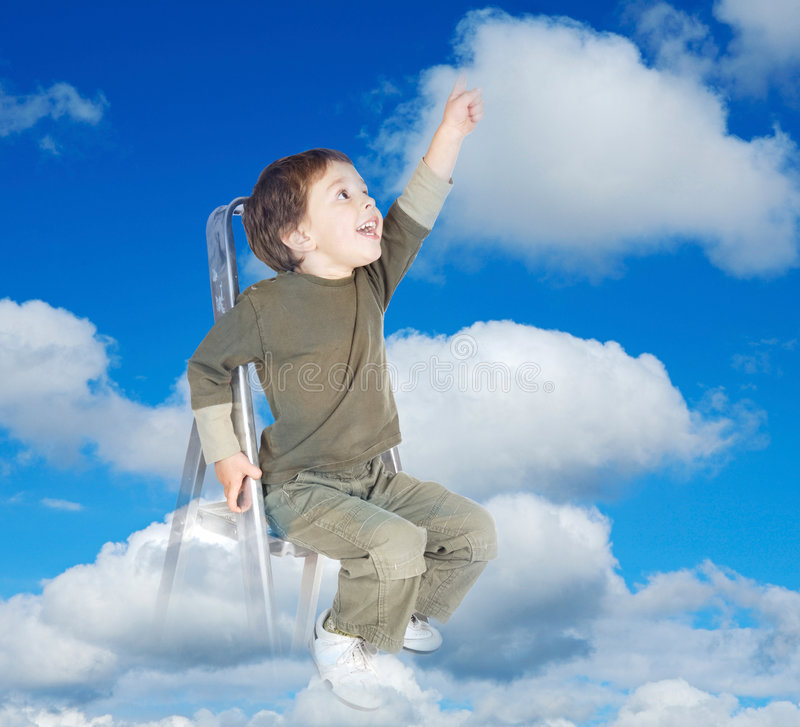 Dreams become real. Adorable child over clouds making reality its dreams stock photos