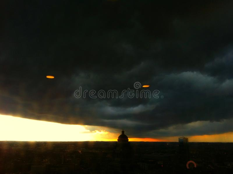 Dreams in Brussels. Rain comes cloud down stock photos