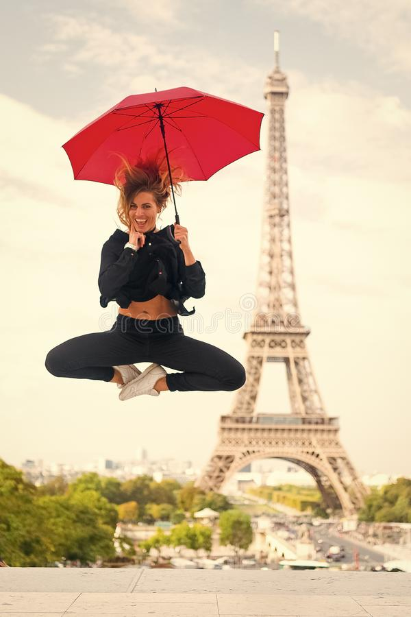 Dreams come true concept. Lady tourist sporty and active in Paris city center jumps up. Girl tourist enjoy walk and stock photo