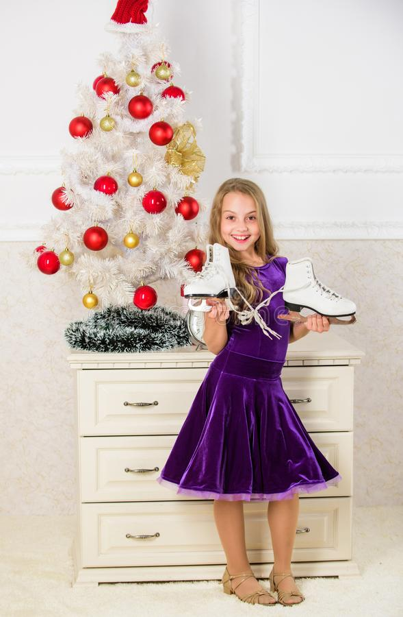 Dreams come true. Got gift exactly she wanted. Figure skating concept. Kid near christmas tree hold skates gift. Little. Girl satisfied christmas gift. Best stock photo