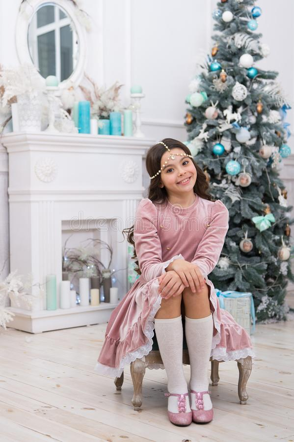 Dreams come true. Hope concept. Dreamy baby christmas wish. Making wish. Waiting for Santa claus. Adorable girl making stock image