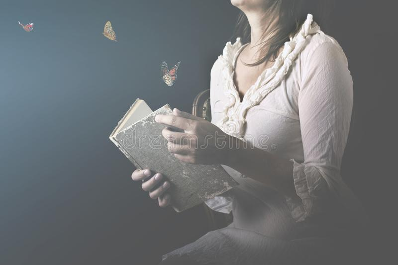 Dreams are transformed into butterflies and come out of a magical book stock image