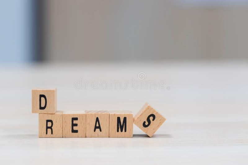 Dreams wooden cubes background royalty free stock photography