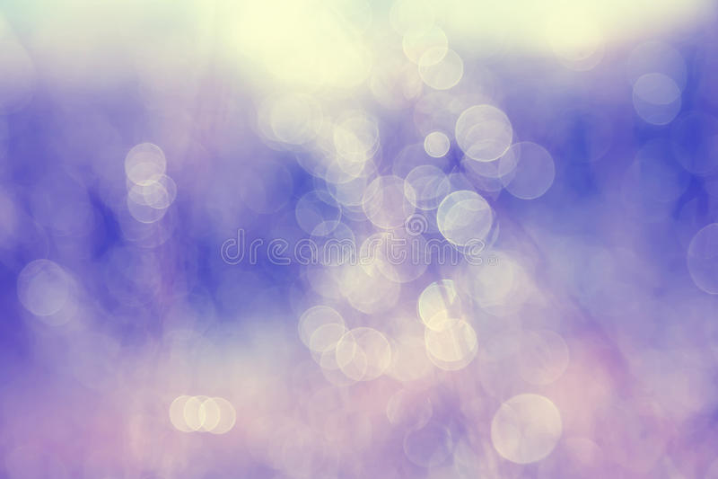 Dreamy abstract winter season blurred nature background. Lovely blurry vintage yellow purple bokeh background stock photos