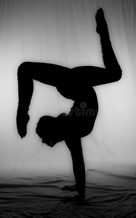 Dreamy Balancing Act. A talented young woman exhibits her abilities stock photos