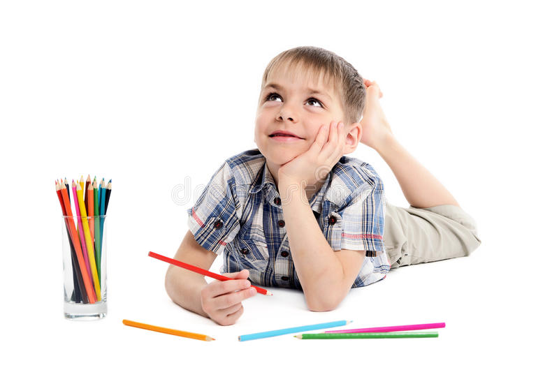 Dreamy Child Boy With Pencils Stock Photos