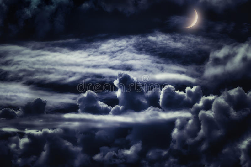Dreamy cloudscape at night with moonlight stock images