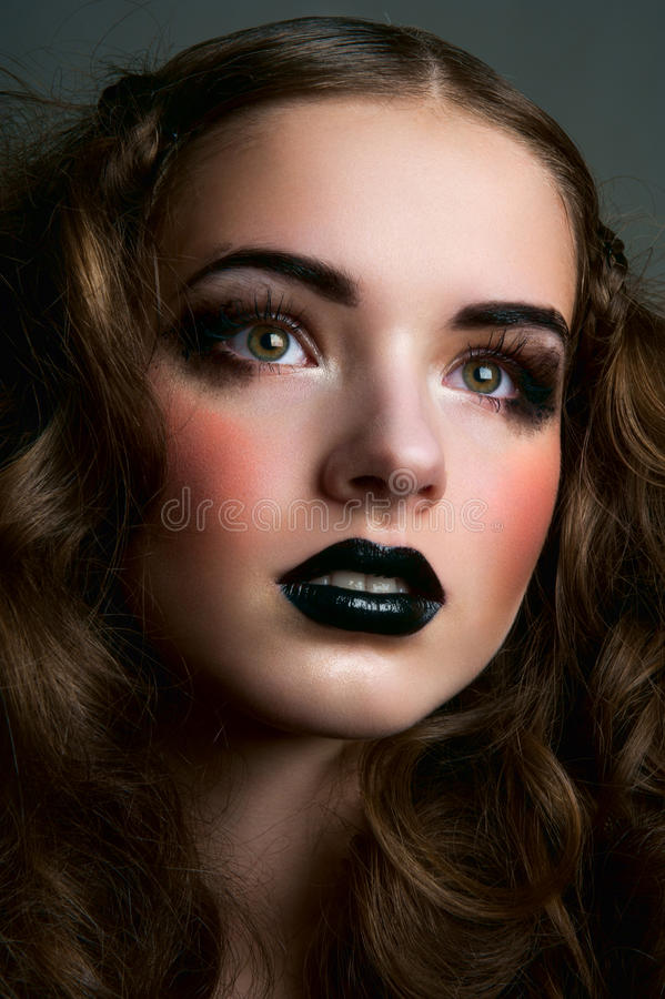 Dreamy fashion beauty girl with black lips stock photography
