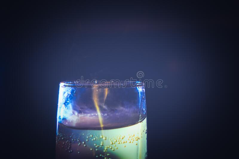 Dreamy looking shot glass on dark background royalty free stock images
