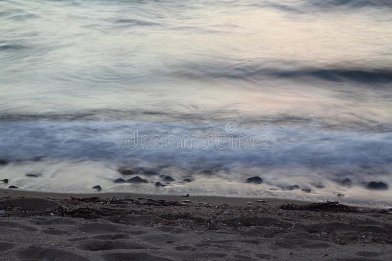 Dreamy natural background with sea shore, rocks and waves. stock photography