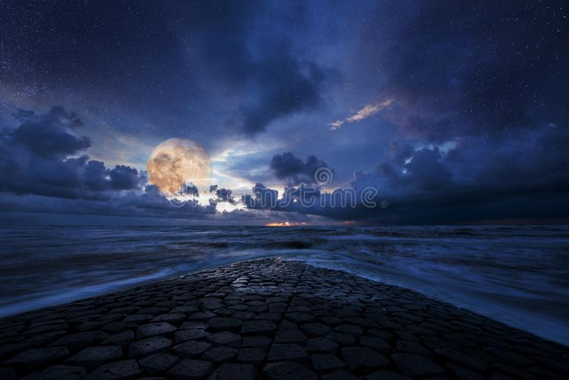 Dreamy night landscape, ocean and sky in moon light royalty free stock images