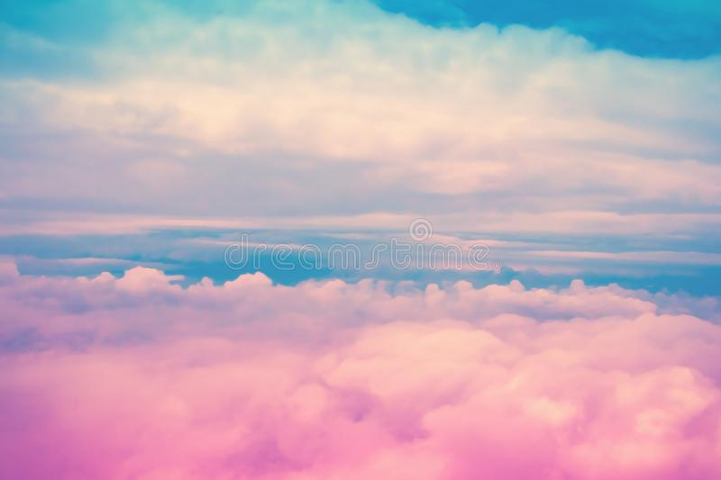 Dreamy pink and blue sky above clouds. Colorful cloudscape background stock image