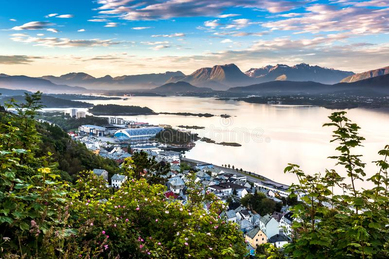 Mountain Landscape with Aerial View of Eastern Side of Alesund, Bay and Mountains in The Morning Sunshine. Image of Alesund in Summer taken from Mount Aksla stock photos
