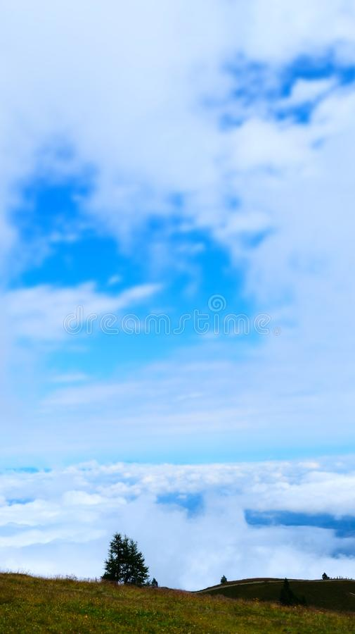 Dreamy sky with green grass, Gerlitzen, Austria stock photo