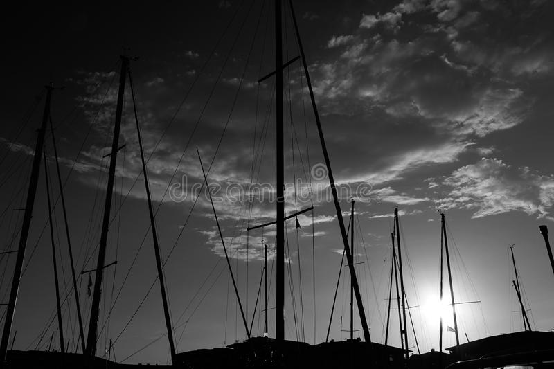 Dreamy sunset above harbour Fréjus france black and white stock photo