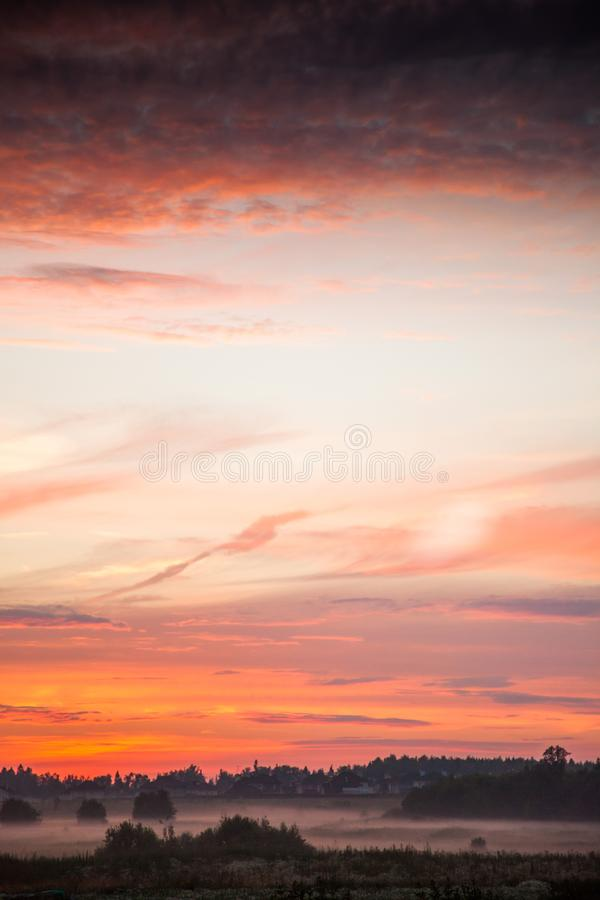 Dreamy sunset at countryside. Flaming skies. Dreamy evening sunset at countryside. Flaming orange skies and foggy field stock photo