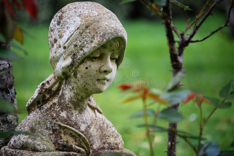 A Dreamy Vintage Aged Garden Statue Of Young Girl Royalty Free Stock Images