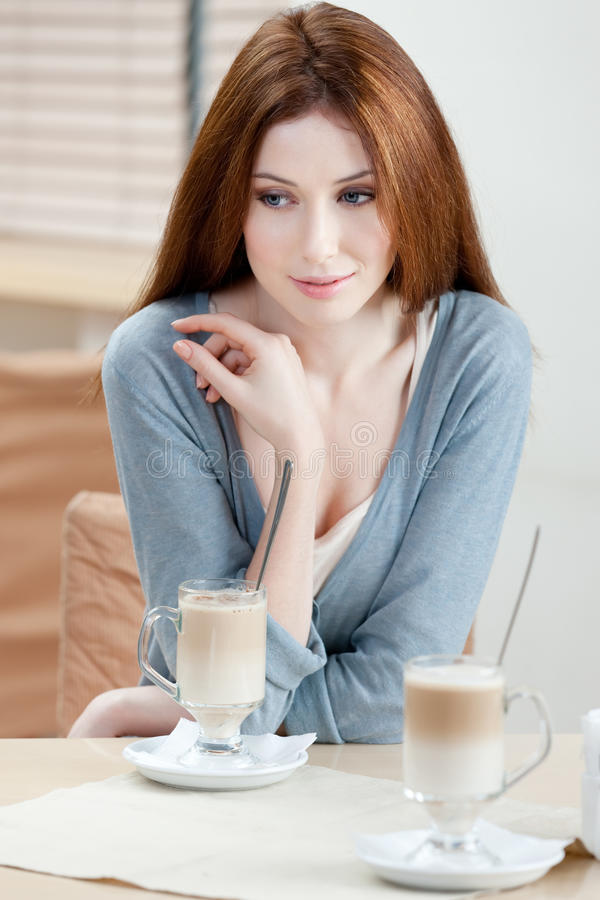 Dreamy Woman With Milk Cocktail Royalty Free Stock Photography