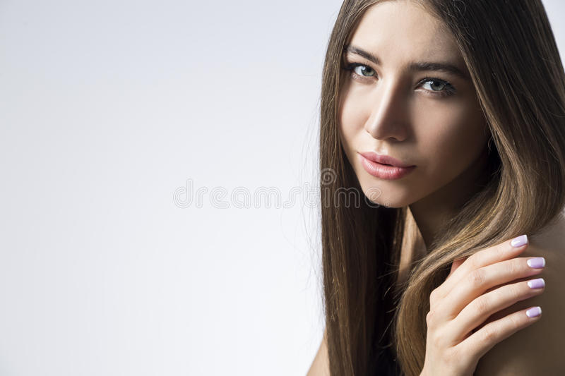 Dreamy woman touching shoulder royalty free stock images