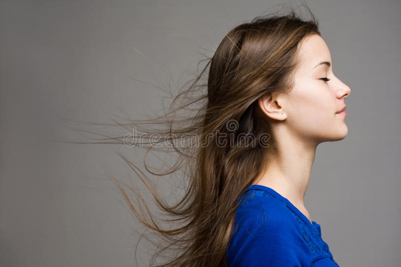Dreamy young brunette. royalty free stock image