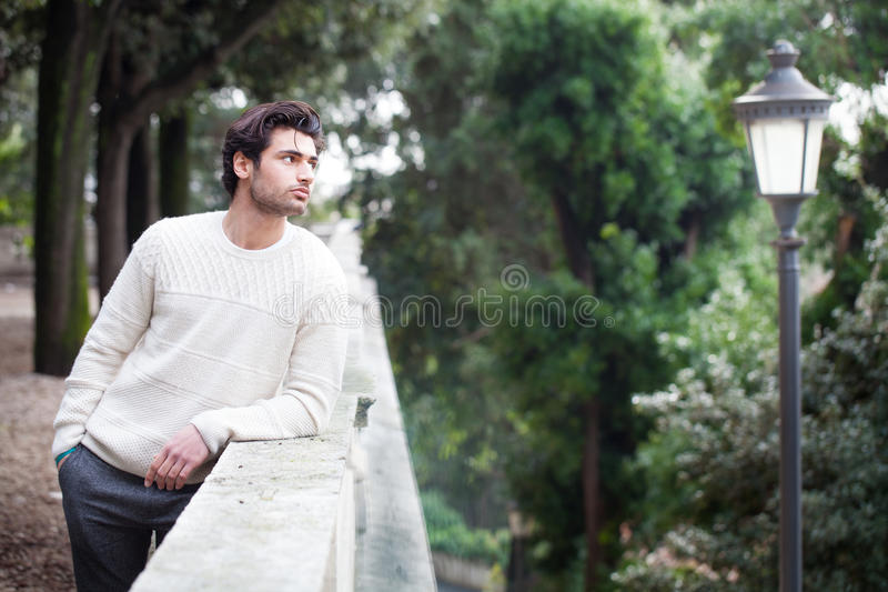 Dreamy young handsome man waiting for the first meeting. Latin lover. royalty free stock images
