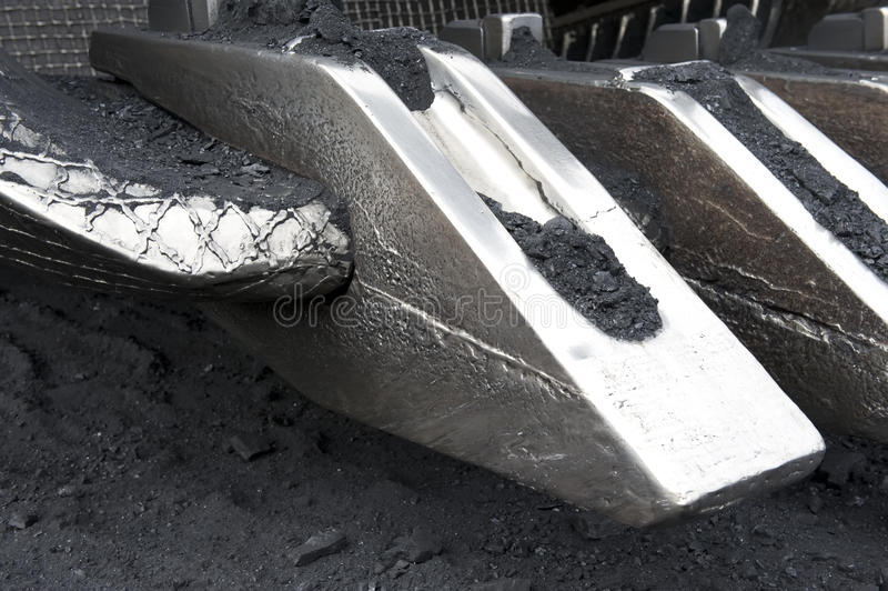 Dredge,. The big, steel ladle of a dredge. Coal mining royalty free stock photography