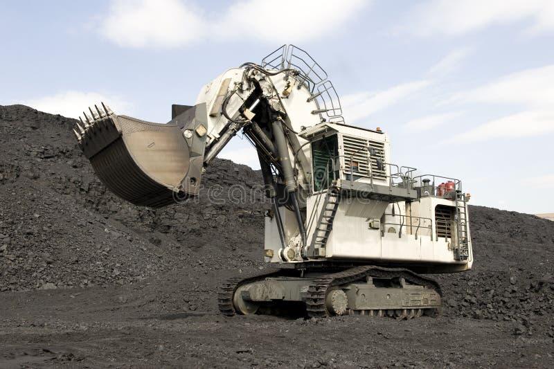 Dredge. Coal mining, ковшовый a modern dredge stock photos