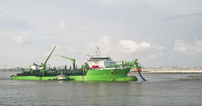 Dredge. In the port of lagos royalty free stock photo